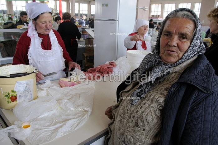 An elderly female customer at a sour cream cheese stall at the main market in Odessa, Ukraine. - Janina Struk - 2012-03-28