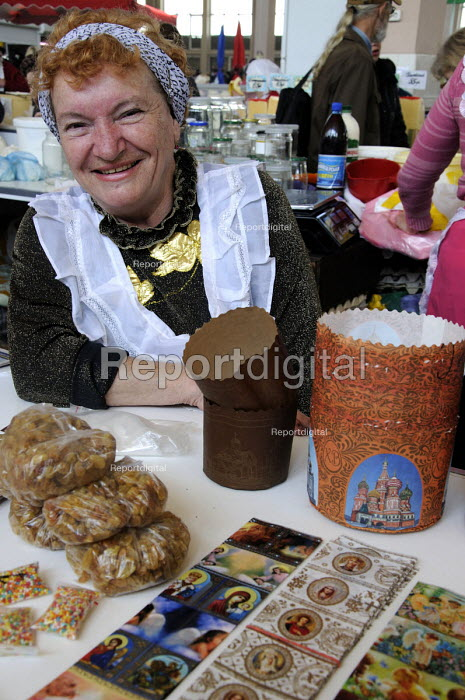 Stallholder selling cake decorations and relegious stickers at the main market, Odessa - Janina Struk - 2012-04-30