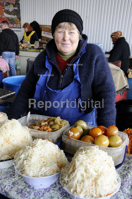 A woman selling cabbage, tomatoes and pickles in the main market in Odessa. - Janina Struk - 2012-03-28