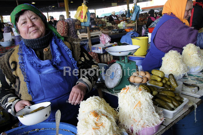 A trader selling cabbage, gherkins and eggs in the main market in Odessa, Ukraine. - Janina Struk - 2012-03-28