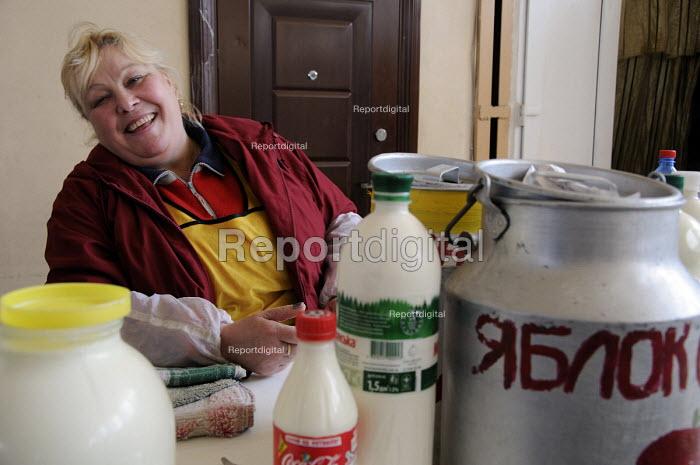 A market trader selling fresh milk at a stall in the main market in Odessa, Ukraine. - Janina Struk - 2012-03-28