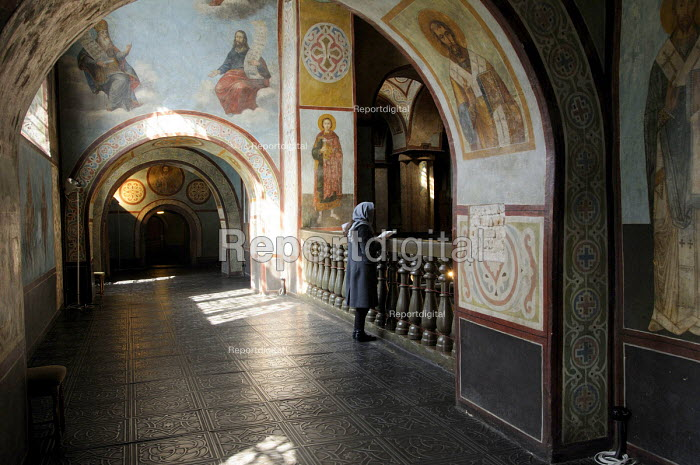 A young woman wearing a headscarf in the interior of St Sophias Cathedral, Kiev, Ukraine. - Janina Struk - 2012-03-24