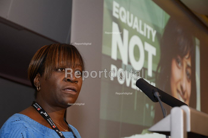 A black woman USDAW delegate speaking at Women's TUC, 2015 with an Equality not Poverty poster in the background. - Janina Struk - 2015-03-12