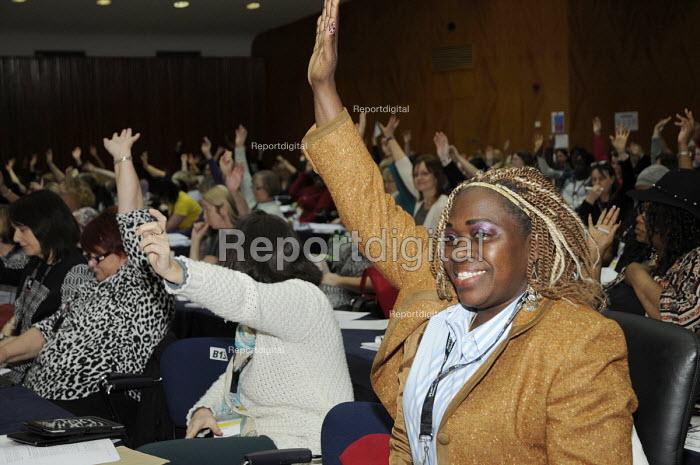 Black woman NASUWT delgate voting at Women's TUC, 2015. - Janina Struk - 2015-03-13