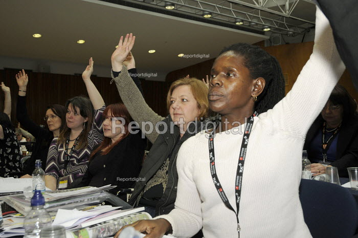 A black woman UCU delegate voting with colleagues at Women's TUC, 2015 - Janina Struk - 2015-03-13