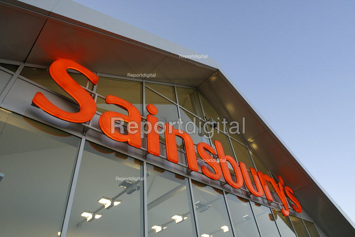 The illuminated orange logo of a Sainsbury's supermarket - John Sturrock - 2002-10-03