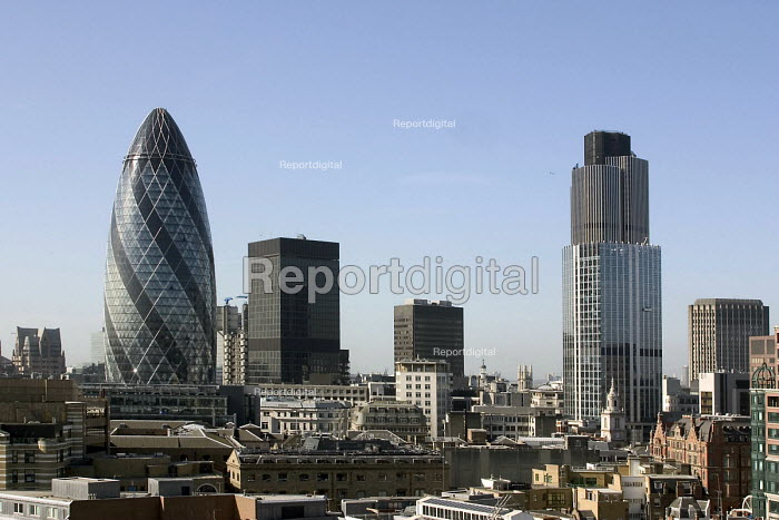 City of London skyline, viewed from the north. The tallest buildings are Swiss Res Gherkin (left) and Tower 42 (formerly known as The Nat West tower). To the right of the Gherkin is the black building of Dresdner Kleinwort Wasserstein, and the Lloyds building can just be seen between them. - John Sturrock - 2004-04-22