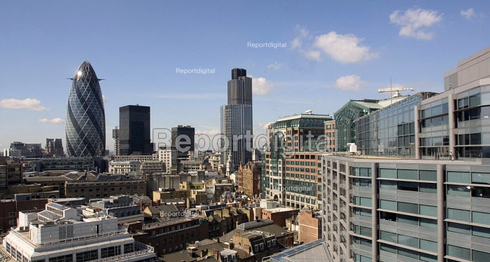 City of London skyline, tallest buildings are Swiss Res Gherkin (L) and Tower 42 (formerly known as The Nat West tower). To the right of the Gherkin is the black building of Dresdner Kleinwort Wasserstein and the Lloyds building is between them. To the right of Tower 42 is the Broadgate estate and the grey building nearest to the camera on the right is 250 Bishopsgate, the ABN Amro HQ. - John Sturrock - 2004-06-22
