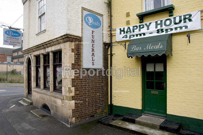 Signs showing the words Funerals and Happy Hour displayed outside a pub and undertakers' premises in Ashford, Kent - John Sturrock - 2004-09-14
