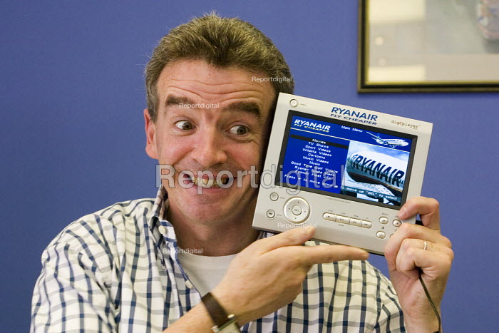 Michael O'Leary, chief executive of Ryanair with a digEplayer, a personal video player available to rent on some Ryanair flights - John Sturrock - 2004-09-21