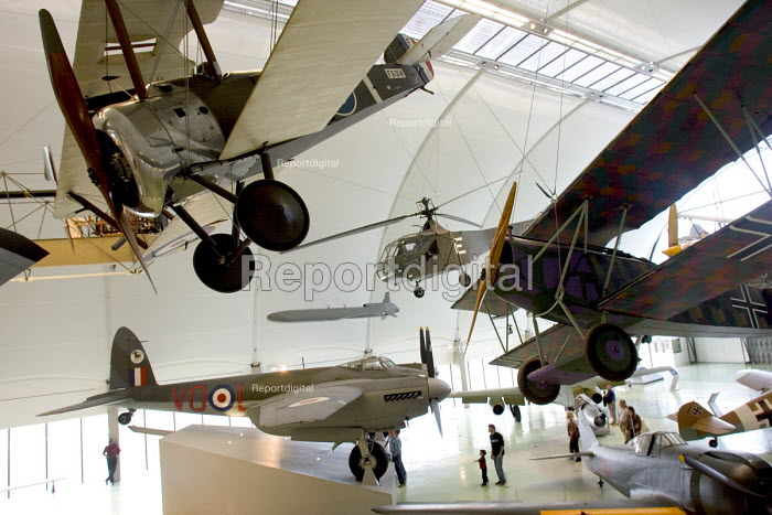 A Sopwith F1 Camel (top left) suspended above a de Havilland B35 in a view of the historic aircraft on display at the RAF Museum Hendon - John Sturrock - 2004-09-24