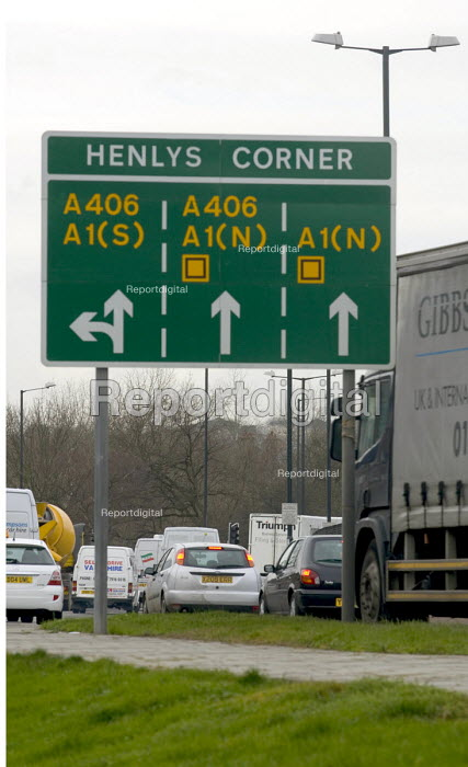 Dense traffic travelling west bound on the A406 North Circular Road starting to form a jam at Henlys corner, the junction with the A1, in north London - John Sturrock - 2005-01-21