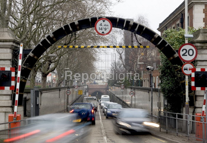 The blurred movement of traffic emerging from the Rotherhithe tunnel through a gauge arch made from a piece of the the tunnel lining, on the south side of the River Thames - John Sturrock - 2005-03-30