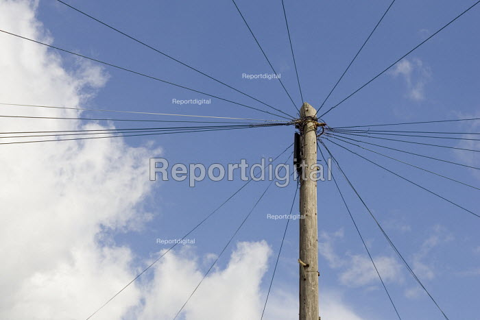 Domestic telephone wires radiating from a telegraph pole. - John Sturrock - 2005-04-07