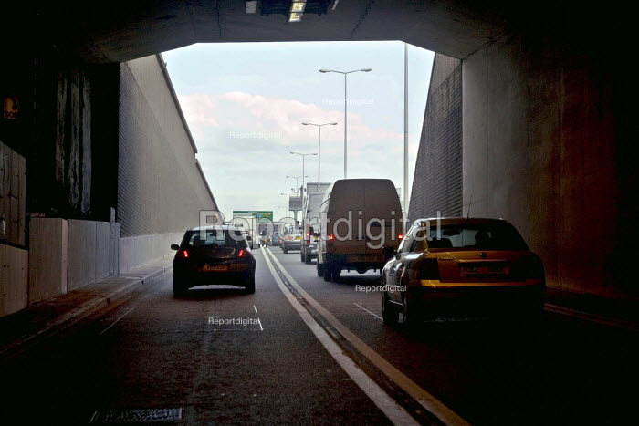 The driver's view of heavy traffic travelling out of the Fore Street Tunnel, Edmonton, along the A406 North Circular Rd, in north east London - John Sturrock - 2005-04-11