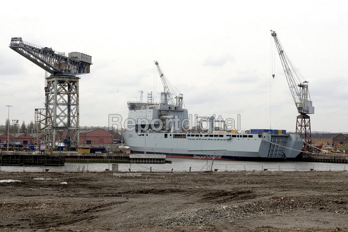 The construction of HMS Daring, the first of the new Type 45 class of Anti-Air Warfare Destroyer for Royal Navy, at BAE Systems Naval Ships yard on the River Clyde at Govan, Glasgow. Looking across the demolished northen bank of the Clyde, awaiting redeveloment as part of the Glasgow Harbour scheme - John Sturrock - 2005-04-20