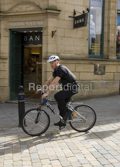 Policeman riding a bike in Stockport - John Sturrock - 2005-04-29