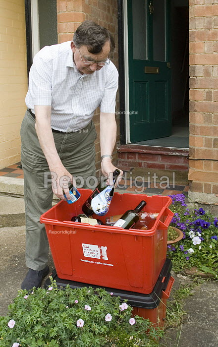 A householder prepares domestic waste for recycling collection - John Sturrock - 2005-05-26
