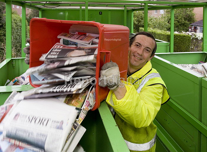 ECT collection for the recyling of domestic waste in Warwick A male worker pours newspaper into a container in the collection vehicle - John Sturrock - 2005-05-26