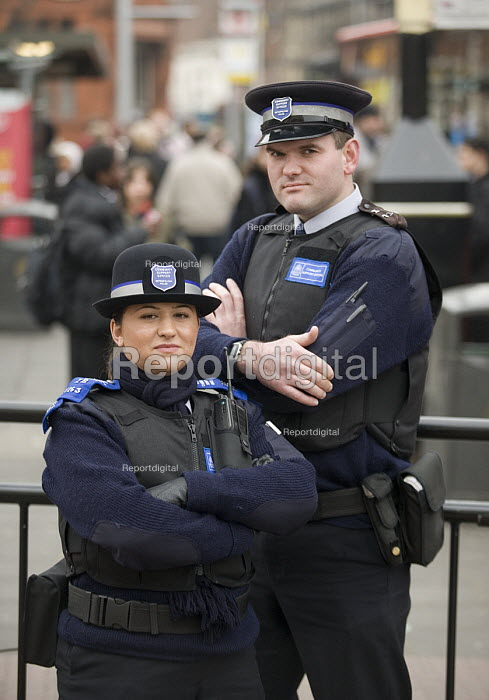 Male and female Police Community Support Officers in Acton, west London - John Sturrock - 2006-02-02