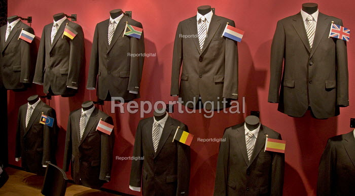 The stand of Dutch consultants from TCN contains executive suits and national flags, at the MIPIM 2008 Cannes - The worlds real estate showcase for property professionals. - John Sturrock - 2008-03-11