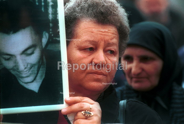 Women holding photographs of missing relatives at demonstration by Serb families whose relatives have been kidnapped in Kosovo. Belgrade, Serbia. 2000 - Andrija Ilic - 1998-07-01