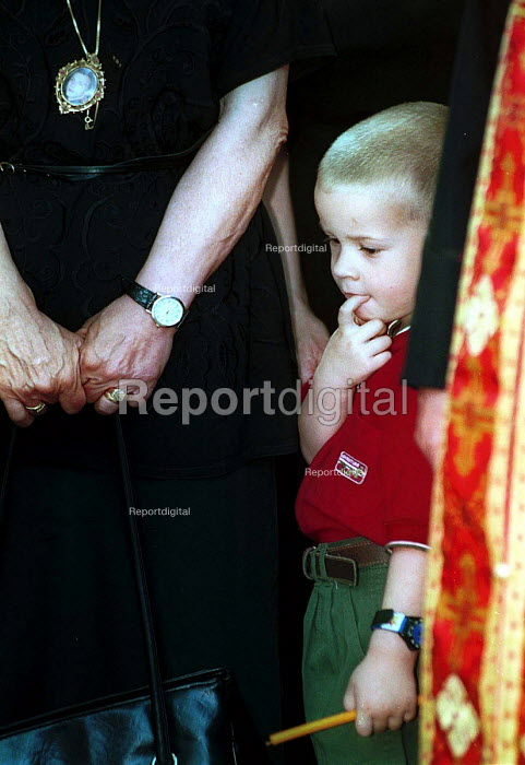 Son attending the funeral of his father, killed when Serb TV Headquarters was hit during NATO bombing. Belgrade, Serbia 1999 - Andrija Ilic - 1999-07-01