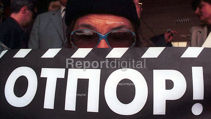 An elderly woman at a protest with an anti-Miloshevic sign reading resistance. Belgrade, Serbia. 1999 - Andrija Ilic - 1999-07-01