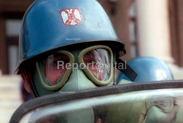 Policemen during anti -Miloshevic demonstration, Belgrade. Serbia. 2000 - Andrija Ilic - 2000-07-01