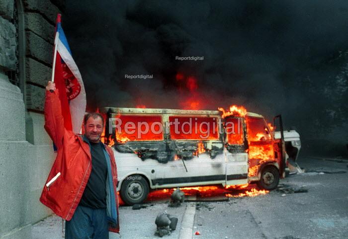 Demonstrator celebrating after the fall of the Miloshevic regime, Belgrade. Serbia. 2000 - Andrija Ilic - 2000-07-01