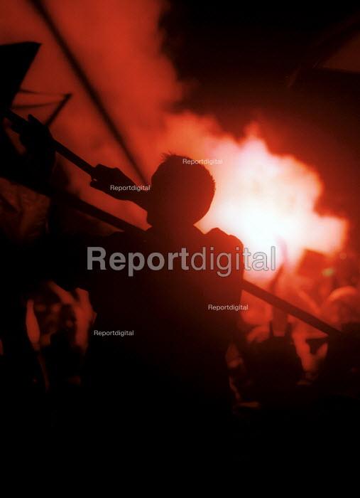 Demonstrators celebrating after the fall of the Miloshevic regime. Belgrade, Serbia. 2000 - Andrija Ilic - 2000-07-01