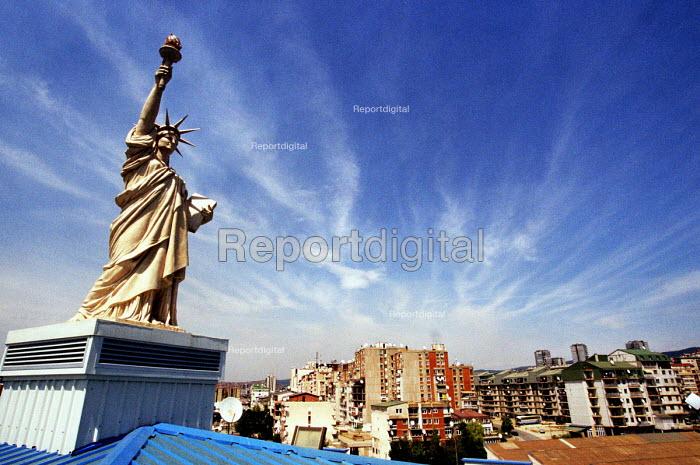 Imitation of Statue of Liberty on the Hotel Victoria in Pristina, Kosovo. 2003 - Andrija Ilic - 2003-07-01