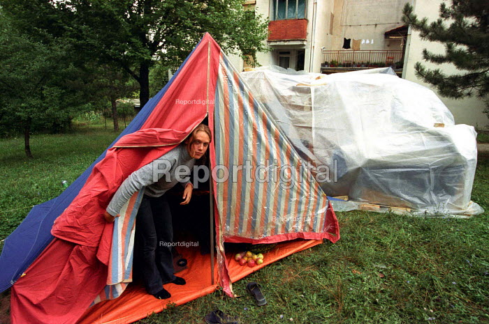 Serb family camping in the yard infront of their building following eviction from their apartment where they had lived for 25 years. The family believe the Court decision was politically motivated as the new owner is a close friend of a ruling political faction. Belgrade, Serbia 2003 - Andrija Ilic - 2003-07-01