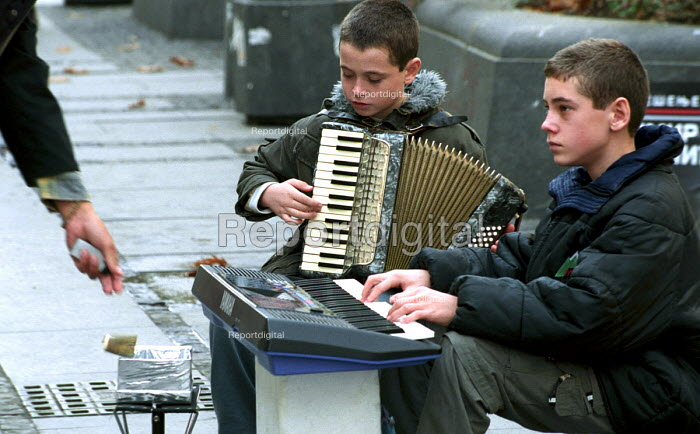 Young boys busking in central Belgrade. Belgrade, Serbia 2004 - Andrija Ilic - 2004-05-06