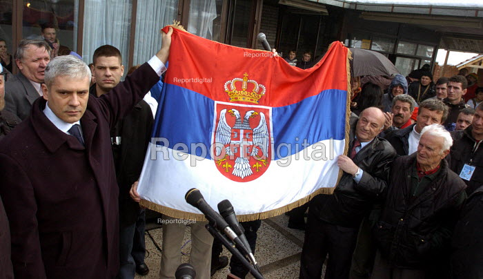 Serb President Boris Tadic holds a Serbian flag as he arrives in the Serb populated village of Strpce in south Kosovo. He is the first Serb head of state to visit the UN ruled province since the 1999 war. Kosovo 2005 - Andrija Ilic - 2005-02-13