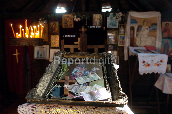 Religious candles with icons at a 14th Century Serbian Orthodox Church in southern Serbia. 2004 - Andrija Ilic - 2004-09-13