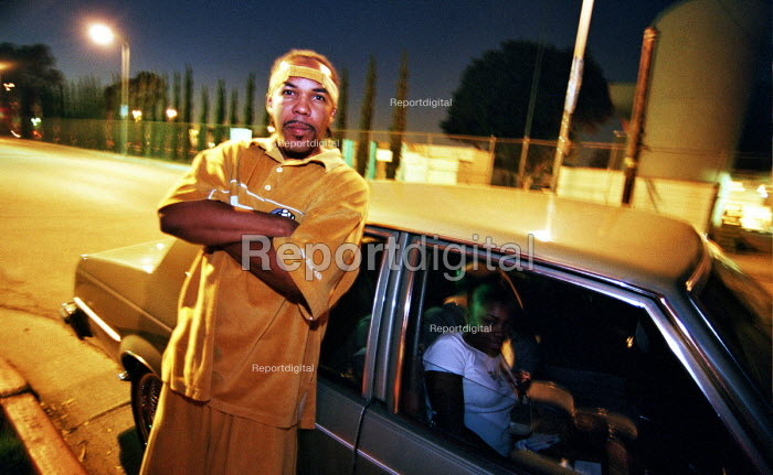 Rap artist posing in front of his car in Watts a poor district of , Los Angeles, USA 2003 - Andrija Ilic - 2003-05-07