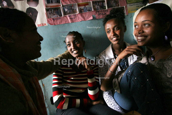 A young Ethiopian woman who has been elected beauty queen at her school, talks with friends about AIDS awareness program in a Youth Association, Dessie, Ethiopia, 2005. - Boris Heger - 2005-06-30