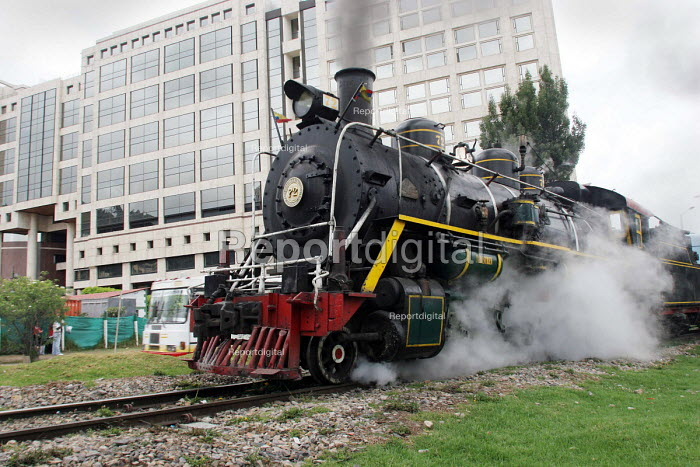 A former engineer with Colombian railways bought the remaining steam trains when the company closed down. A passionate enthusiast for steam he has gathered a team of engineers to renovate the trains, some of which are now running again. Bogota, Colombia 2004 - Boris Heger - 2004-09-01