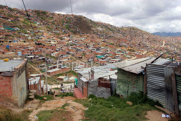 Slum area of Bogota.There are two million displaced persons in Colombia, many of whom have moved to the big cities where they live in very poor conditions in slum areas. Bogota, Colombia 2004 - Boris Heger - 2004-09-01