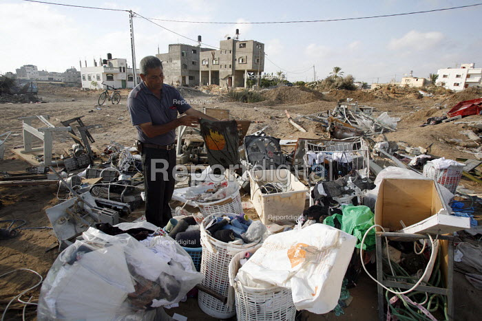 Central Gaza Strip. Mr Ahmed Abdiljawad stands amongst what used to be his textile factory. Destroyed by Israeli tanks during a military operation inside Gaza. - Thomas Morley - 2006-07-27