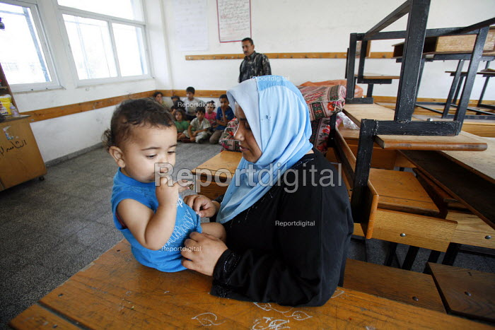 Palestinian children shelter in a classroom in a school in Jabalya refugee camp in the Gaza Strip after they were forced from their homes by the Israeli military. Over the last two weeks over 500 Palestinian people living in the Gaza Strip, close to the Israeli border, have been forced to flee their homes due to constant shelling from Israeli tanks. - Thomas Morley - 2006-07-29