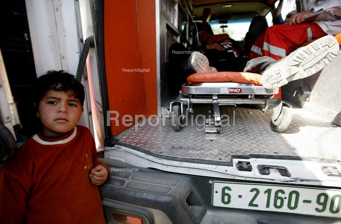 Land Day protests in the West Bank. A young Palestinian boy waits at the doors of an ambulance while his father is treated for a rubber bullet wound. Ramallah, West Bank 2006 - Thomas Morley - 2006-03-30