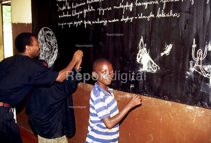 Street children at a home run by a Swiss aid agency where they provide shelter and accommodation. Bujumbura, Burundi. 1995 - Howard Davies - 1995-05-03