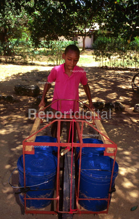 Intermedaite technology used for a water carrier developed by a lcoal NGO. Mtwara District, Tanzania. 2000 The provision of clean drinking water prevents water borne disease. - Howard Davies - 2000-05-03
