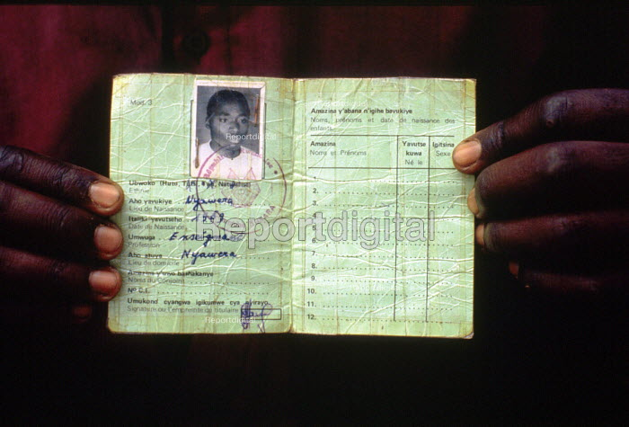 Rwandan refugee with ID card showing ethnicity. The cards were used by Hutu extremists to identify Tutsis during the genocide. Benaco camp, Tanzania. 1994 - Howard Davies - 1994-05-03