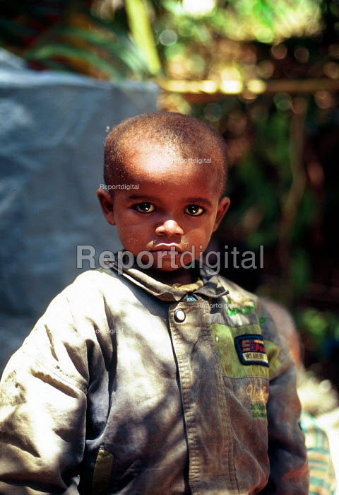 Rwandan Hutu refugee children in care of Red Cross await repatriation. The children survived a massacre in revenge for the 1994 genocide. Kisangani, Zaire - Congo 1997 - Howard Davies - 1997-05-03