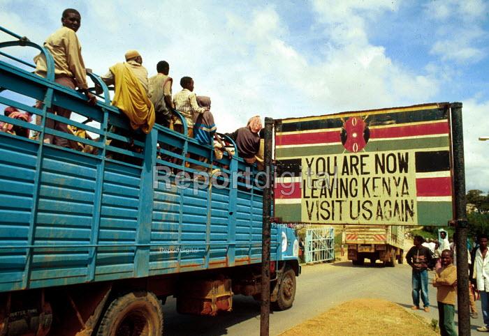 Ethiopian refugees returning home on trucks across Kenya - Ethiopia border part of UNHCR repatriation. 1993. - Howard Davies - 1993-05-03