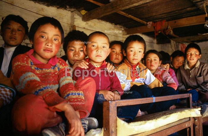 Tibetan refugees at a halfway house having walked from Tibet over the Himalayas to escape Chinese occupied Tibet.. Kathmandu. Nepal. 1997 - Howard Davies - 1997-05-03