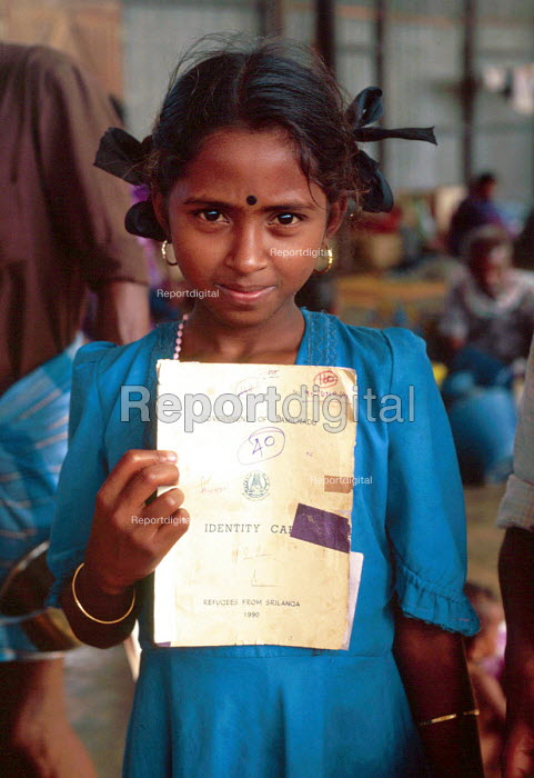 Tamil refugee child with IDP documents upon returning home having been refugees in India. Mannar Island reception centre, Sri Lanka. 1995 - Howard Davies - 1995-05-03
